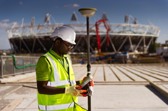 photo of site engineer with olympic stadium in background